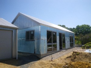 Jan 3, 2014: windows installed and cladding going on. Front looking SW.