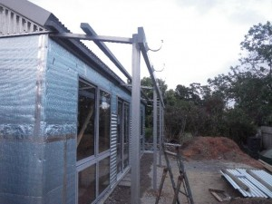 Jan 10, 2014: completing the steel frame for the front verandah and installing the gutter.