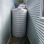 Jan 16, 2014: Rainwater tank delivered today. Tight squeeze between the house and the garage but made it.