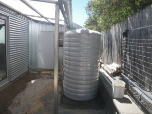 "Jan 16, 2014: Rainwater tank in place. Clark Tanks ""Slimline"" 5000lt polyethylene coloured to match our ""Shale Grey"" colour bond."