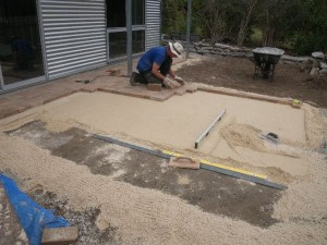 Jan 22, 2014: laying pavers in the front patio. Pavers were reclaimed from the local quarry where they had been dumped for crushing. $20/ton... nice!