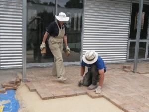 Jan 22, 2014: Jane and George Lemann laying pavers.