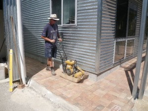 Jan 29, 2014: Compacting the pavers once the concrete is set.