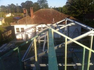 Dec 3, 2013: Frames completed for both house and garage. Looking E towards main house.