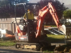 Dec 10, 2013: Digging across the driveway for the sewer line.