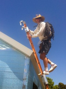 Dec 3, 2013: Bug Man heading up the roof to install foam closure strips under the ridge flashing