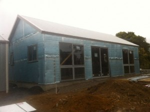 Dec 24, 2014: Windows installed, exterior closed in - front looking SW