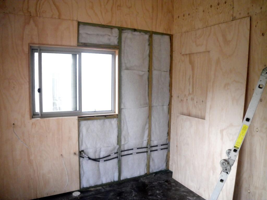 Polyester batt insulation in the Greeny Flat walls