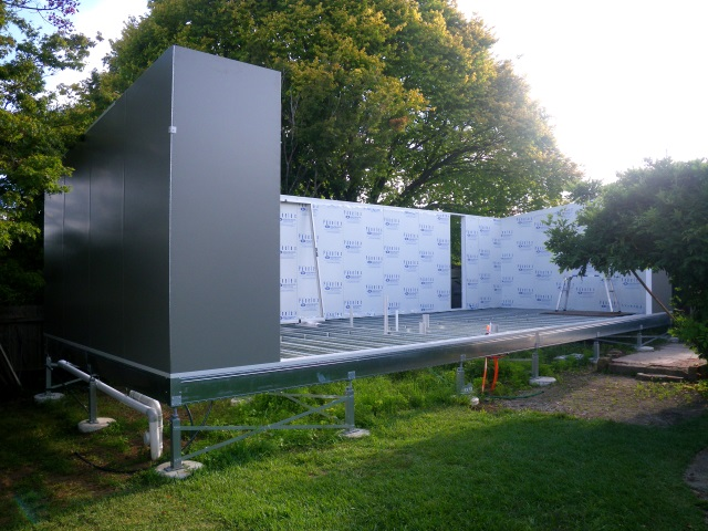 Mittagong granny flat with walls and roof of steel-clad foam-core SIPS panels.