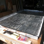 Glueing the old aluminium foil back onto the face of the styrofoam insulation