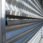 Installing the mounting rail using the existing screws in the corrugated cladding