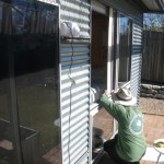 George installing the plywood spacer in the sliding window