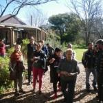 Judith guides the tour through the medicinal plants near their house