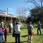 The tour in front of Judith and Paul's solar-powered house