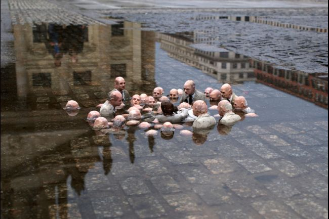 'Politicians Discussing Global Warming' by Isaac Cordal