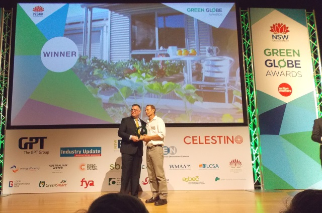 Andy accepts the Green Globe award for 'Excellence in Sustainability - Residential Projects'.