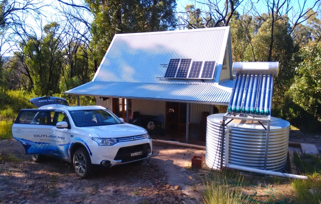 Our Mitsubishi Outlander PHEV outside uncle Simon's cabin in the Warrambungles