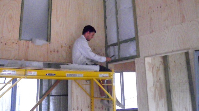 Daniel helping to insulate the Greeny Flat