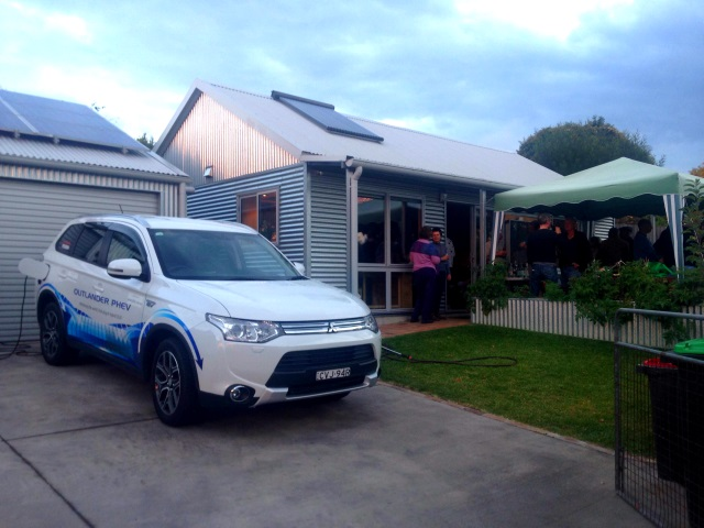 Our PHEV outside the Greeny Flat and charging from the solar system on our garage.