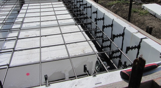 Styrofoam is commonly used to insulate under concrete floor slabs