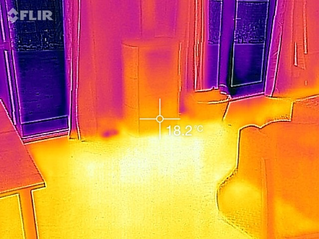 IR image of the new house showing the heat stored in the floor from the fireplace.