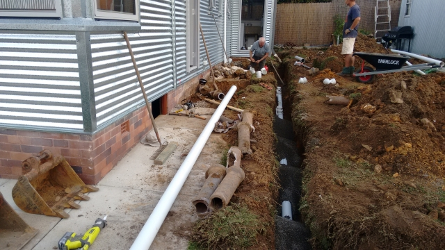 Replacing the sewer lines down the west side of the house next to the Greeny Flat.