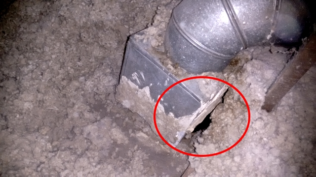This duct boot has become disconnected and is leaking hot air into the attic