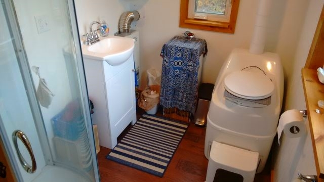 Tina's new bathroom complete with hot and cold running water, shower, sink, gas water heater and composting toilet