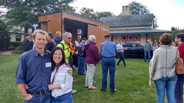 CIntia and I in front of the Tesla Tiny house while Matt Simms from Simmark enthrals the crowd.