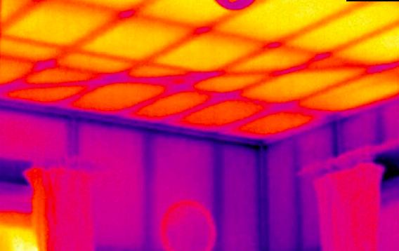An uninsulated ceiling glowing like a radiator.