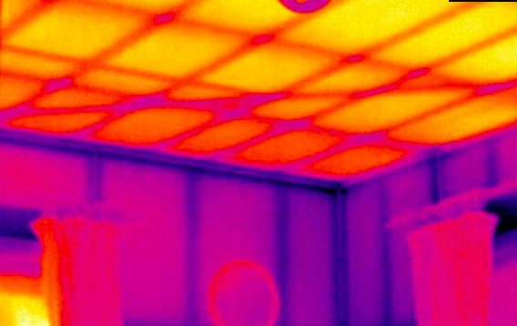 An uninsulated ceiling glowing like a radiator.