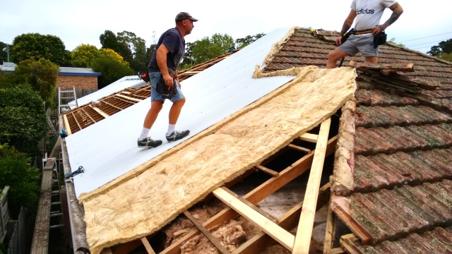 Yesterday we began the job of replacing the tile roof on the old cottage next to the Greeny Flat