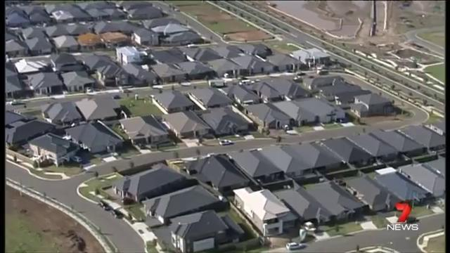 A typical new subdivision in NSW with massive houses built inches apart and covered with dark tile roofs. No open space, no thought given to solar access, or ventilation or orientation or energy efficiency. (Image source: 7News)