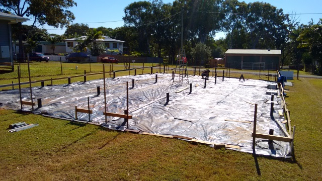 Building up off the ground on steel 'stumps' will allow breezes to move all around and under the house in summer to help keep it cool.