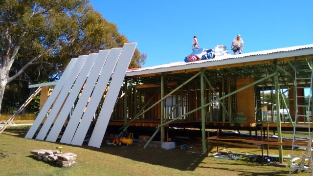 Installing the roof which is a light-coloured Colorbond to reflect the Queensland heat.