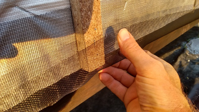 We'll wrap the screen around the furring strips so it covers the gap at the bottom.