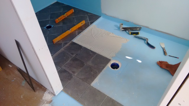 Tiles going down in the ensuite.