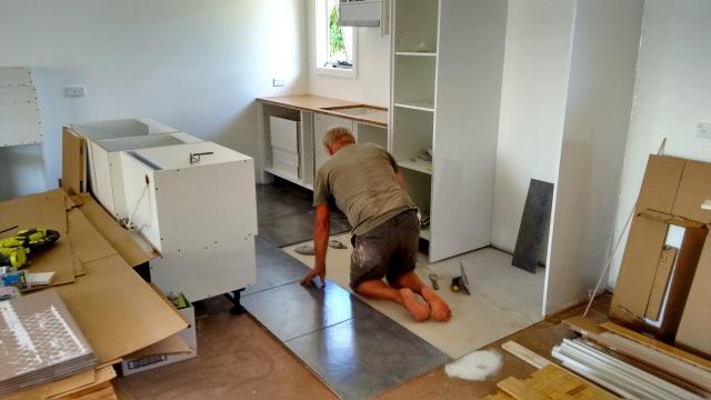 Hans tiling the kitchen floor