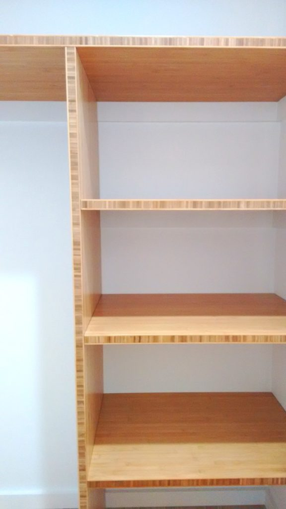 Laminated bamboo panels used for shelving in our hall closet