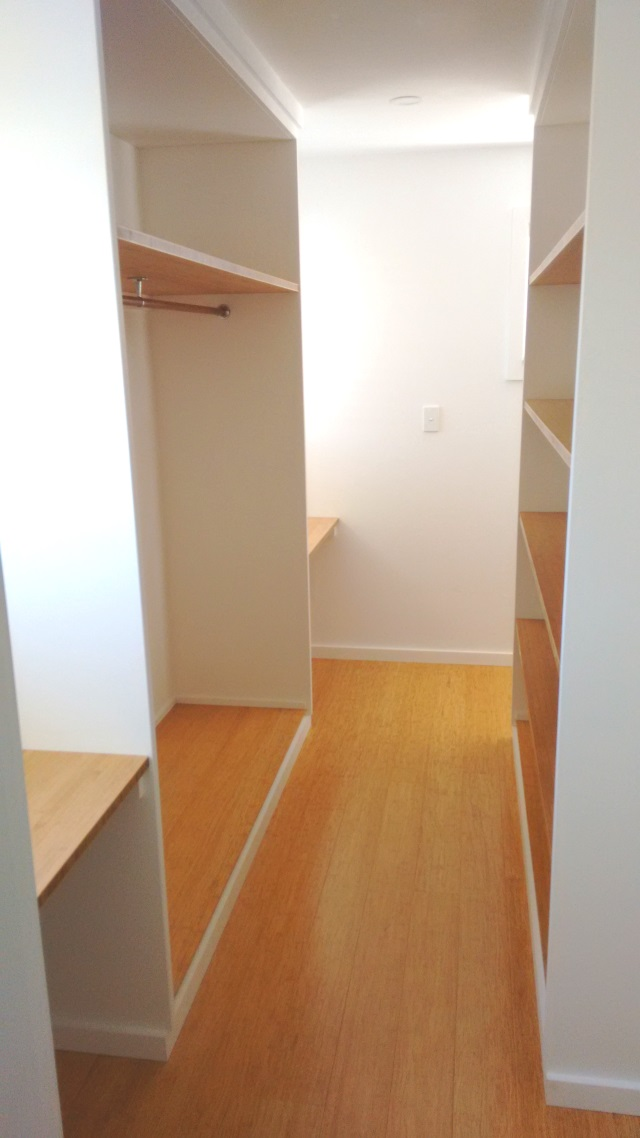 The same bamboo panels used for shelving the walk-in wardrobe.