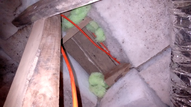 This photo shows where insulation was moved to allow wires to be installed and then wasn't put back.... bloody typical!