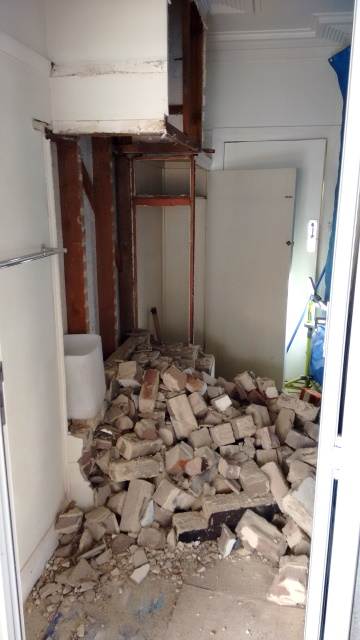 The old brick chimney in the kitchen had served its purpose and was in the way of where we need a new door so out she comes.