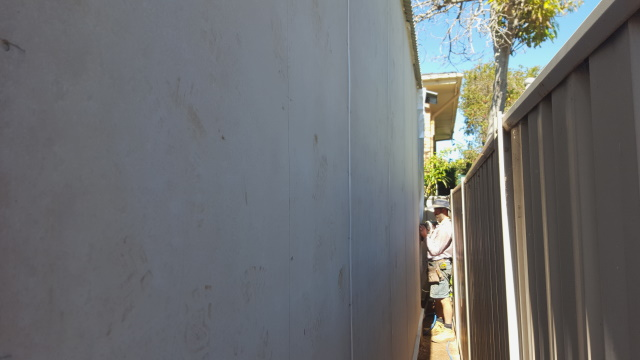 Then installing 6mm fibre-cement board over the entire wall (tricky when it's only 350mm from the fence).