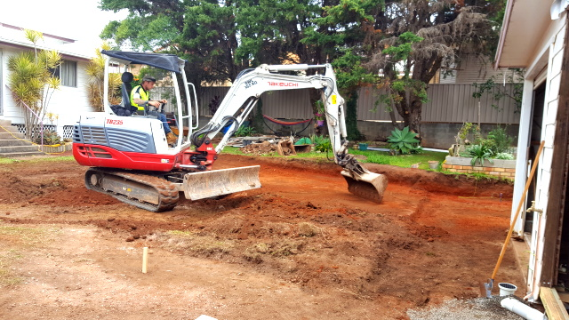 Backfilled the trenches, dug out an area for the carport and regraded the slope of the backyard.