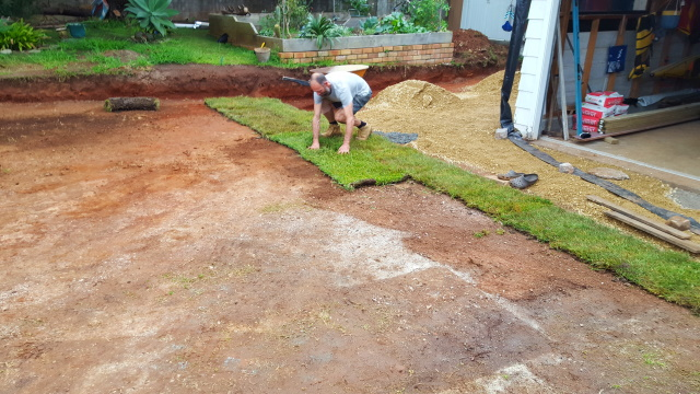 ...laid some turf and started spreading some gravel in the carport space...