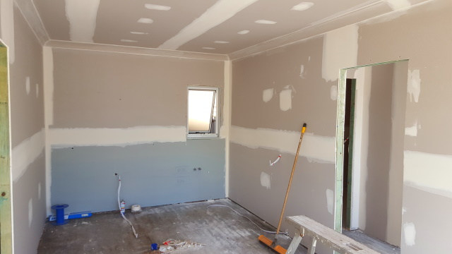 Plastering complete and ready to sand.