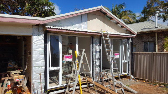 Meanwhile we moved to the north wall, put the roof on the shade awning and started cladding the gable end.