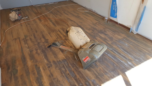 Sanding the old garage floors ready for sealing.