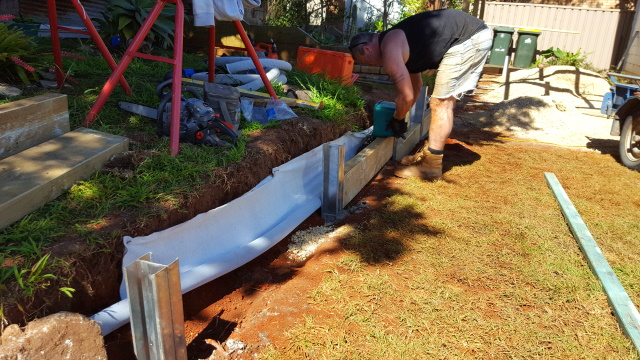 And building a retaining wall...